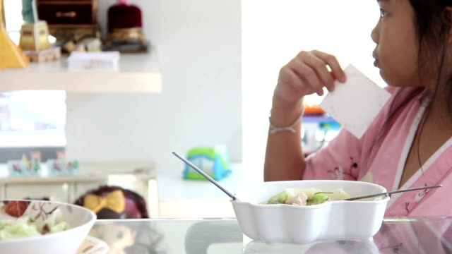asian girl play waiting eating food video