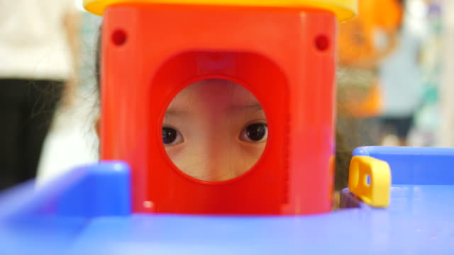 Asian girl playing toy in shopping mall video