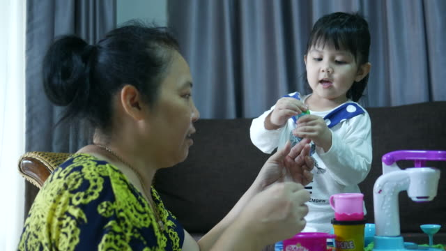 Asian girl playing trade ice cream with grandmother video