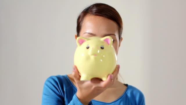 asian girl showing piggybank and euro coin video