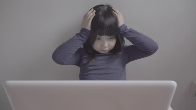 Asian girl using computer at home video
