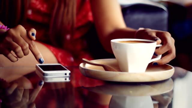 Asian girl using smart phone in restaurant video