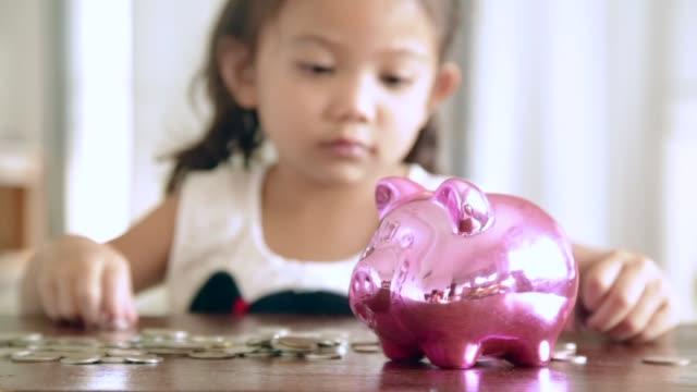 Asian girl with saving money, Deposit