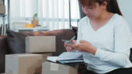 istock Asian girl working small business entrepreneur SME a new start up in the present for online shop  packaging startup entrepreneur seller packaging and delivery 1234920107