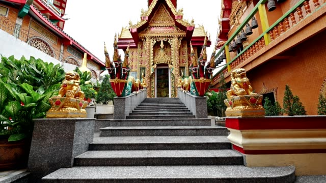 Asian golden carve church with chinese tower and marble stair