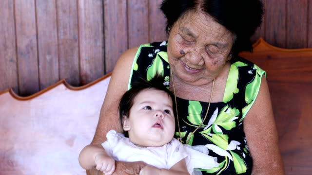 Asian grandmother with her granddaughter video