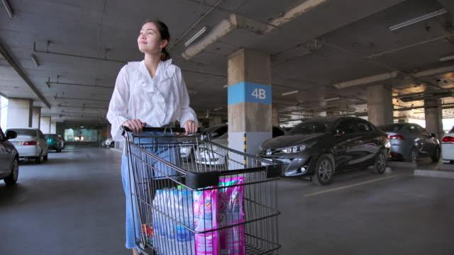Asian Hoarder woman shopping in supermarket 4K Slow motion Asian woman Walking Shopping cart In supermarket woman pushing cart stock videos & royalty-free footage