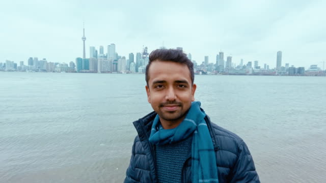 Asian Immigrant in Canada & Futuristic Toronto Skyline from Lake Ontario