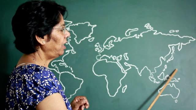 Asian Indian Senior Woman Teacher Teaching Geography video