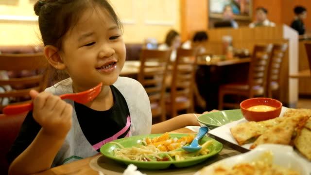 Asian Little  Girl Eating spaghetti video