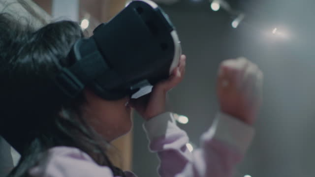 Asian Little Girl In VR Headset At Home video