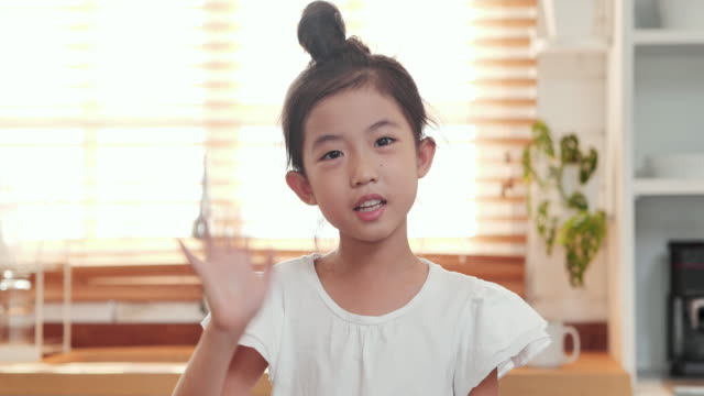 Asian little girl is vlogging (video blogging)to share everything on social media.Video Conference, Video call, Leadership, Vlogging & Influencer, Social teleconferencing video