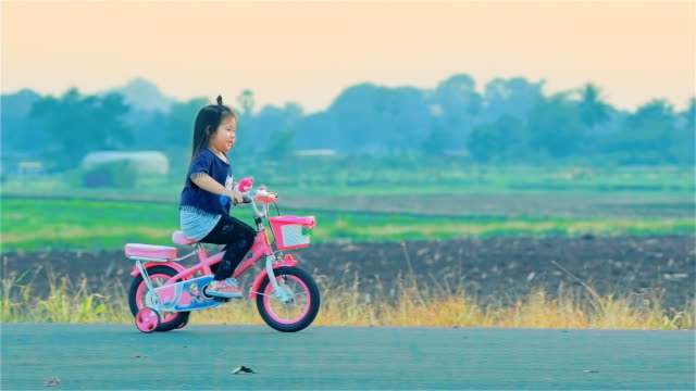 Asian Little Girl On Cycle Ride In Countryside video