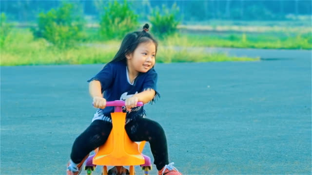 Asian Little Girl Playing Swing Car In Countryside video