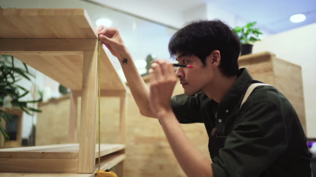 asian man assembling new furniture at home - new normal video stock e b–roll