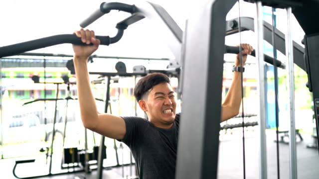 Asian man doing exercise on pull-up bar video
