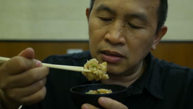 Asian man eating food video