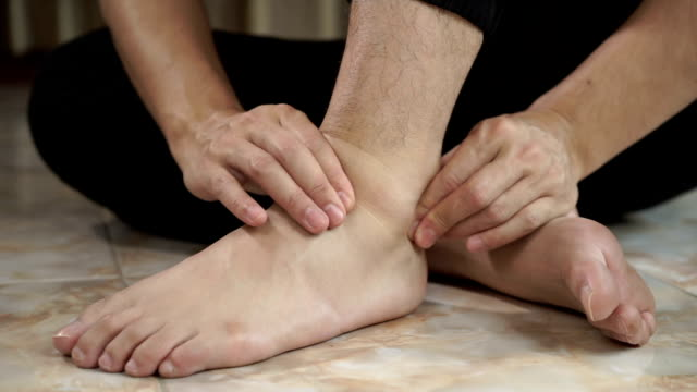 asian man feel pain on his foot and he massage on his foot asian man feel pain on his foot and he massage on his foot ankle stock videos & royalty-free footage
