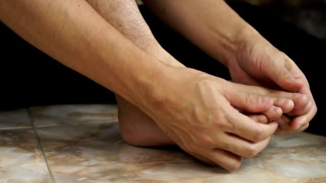 asian man hand massage on his feet video