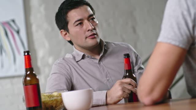 Asian Man Listening Friend at Party - vídeo