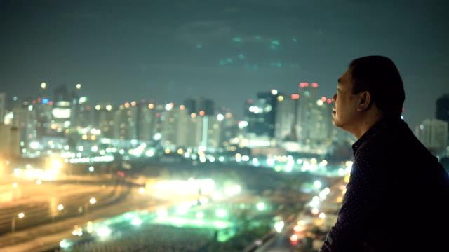 Asian Man Looking At City View