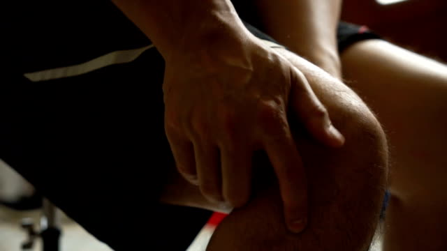Asian man massage on his knee pain and feeling bad Asian man massage on his knee pain and feeling bad knee stock videos & royalty-free footage