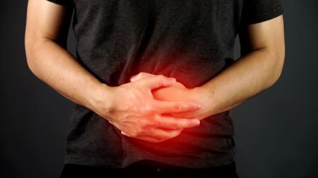 asiatischer mann magenschmerzen - menschlicher verdauungstrakt stock-videos und b-roll-filmmaterial