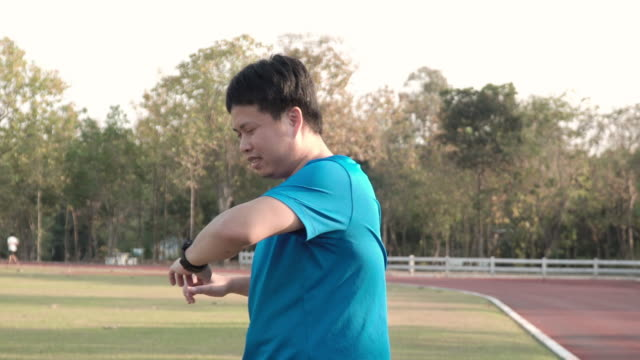 asian man stretching up before running. - man city exercise abs video stock e b–roll