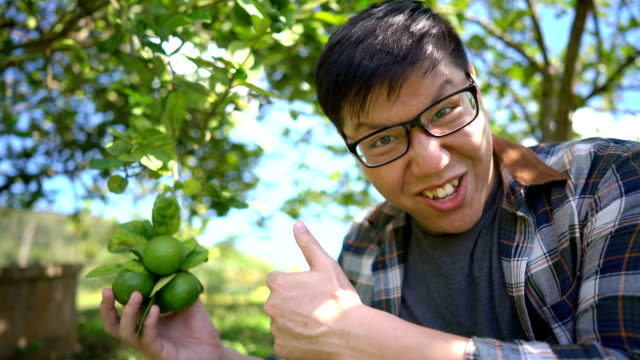 Asian Man Surprise with Local Agriculture Product (Lime) video