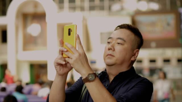 Asian Man Taking photos