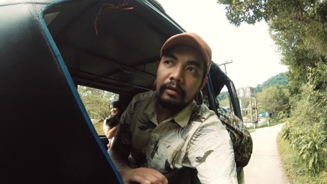 Asian Man Taking Road trip Selfie