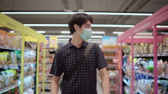 Asian Man using Pollution mask In Grocery