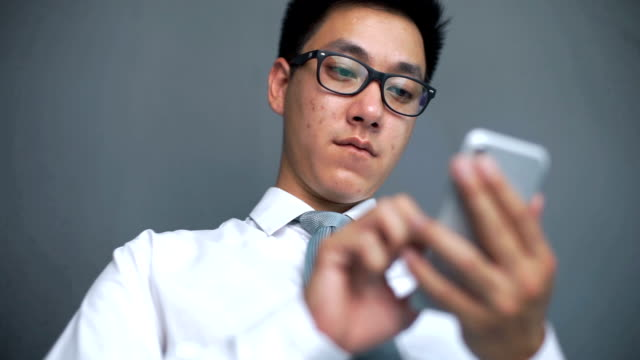 Asian man using smartphone, he is social addict video