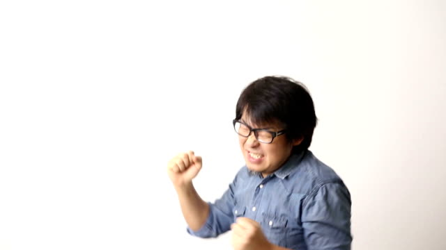 Asian Man The Asian man on the white background. excitement stock videos & royalty-free footage