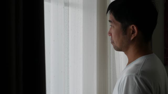 Asian man wearing mask before go outside house