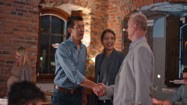 Asian man welcoming a client in the startup office video
