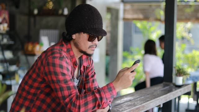 Asian man with backpack traveler using the smart mobile phone for Video call and taking photo