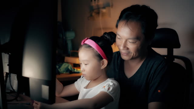 asian man working from home with his daughter enjoying a smartphone. - padre single video stock e b–roll