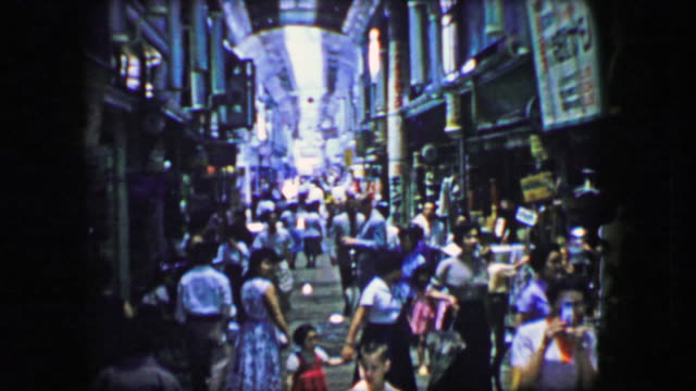 1944: Asian market busy people walking fast indoor high ceilings building. video