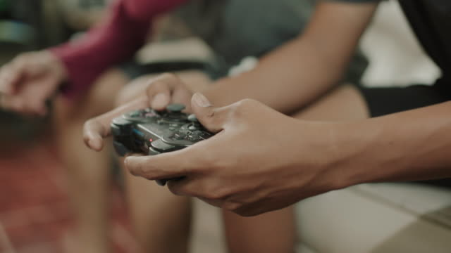 Asian Men playing video games