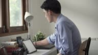 istock Asian men use tablets to teach online. 1275760810