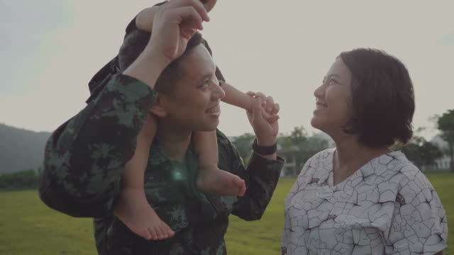asian military soldier reunites with son - military lifestyle stock videos & royalty-free footage