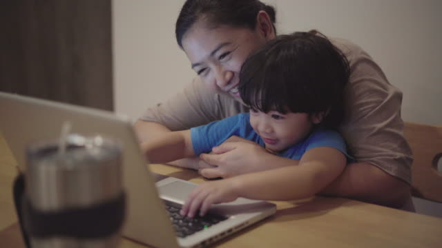 Asian Mother is working at home video