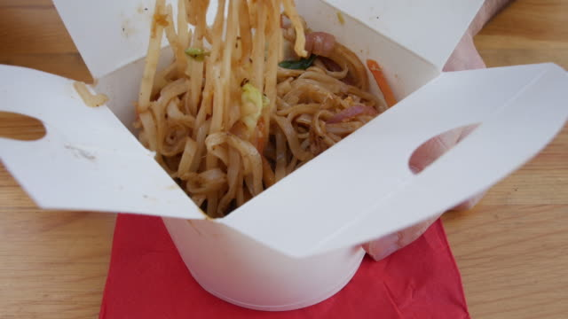 Asian noodles in a takeout box - chinese thai delicious vegan food