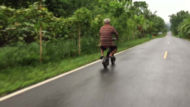 Asian old man riding scooter video
