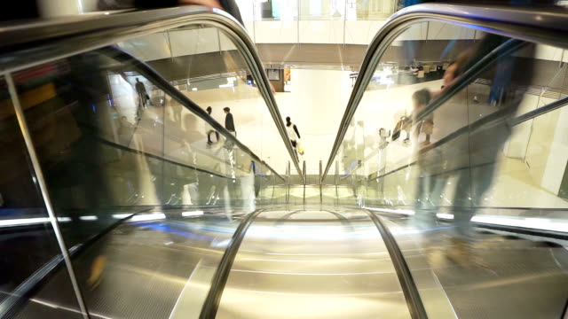 Asian people on shopping mall escalator, time lapse. video