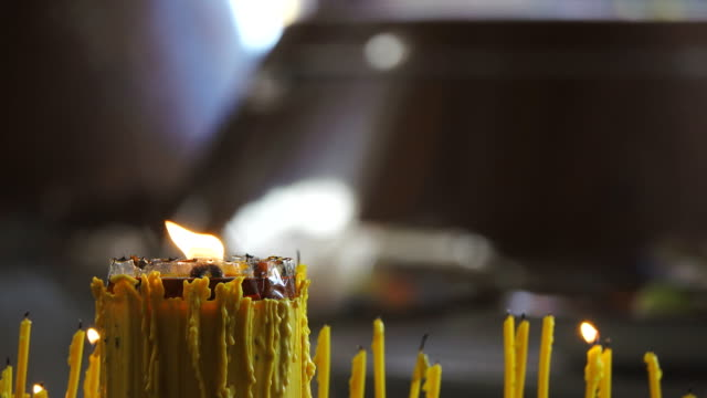 Asian People Praying Buddha With Lotus Candle And Incense
