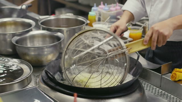 Asian restaurant, professional chef cooking food, man, chinese cook working video