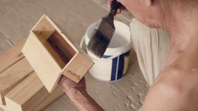 Asian senior man renovating old furniture video