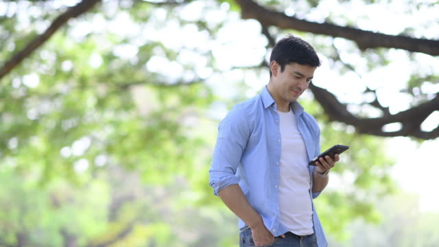 Asian senior man using moble phone